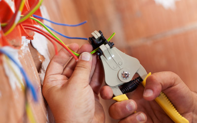 Electrician peeling off wires